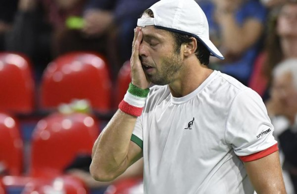 Italy's Paolo Lorenzi reacts during the Davis Cup World Group Quarterfinal match against Belgium's David Goffin, at the Spiroudome de Charleroi stadium, in Charleroi, Belgium, Sunday, April 9, 2017. (ANSA/AP Photo/Geert Vanden Wijngaert) [CopyrightNotice: Copyright 2017 The Associated Press. All rights reserved.]