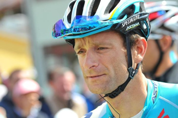 Michele Scarponi of Astana team during signature operations bepore the departure for the sixth stage, 247 km from Sassano to Montecassino, of the 97th Giro d'Italia cycling race, Italy, 15 May 2014. ANSA/LUCA ZENNARO