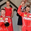 Winner Ferrari's German driver Sebastian Vettel (R) celebrates on the podium next to second placed Ferrari's Finnish driver Kimi Raikkonen after the Monaco Formula 1 Grand Prix at the Monaco street circuit, on May 28, 2017 in Monaco.  / AFP PHOTO / Pascal GUYOT