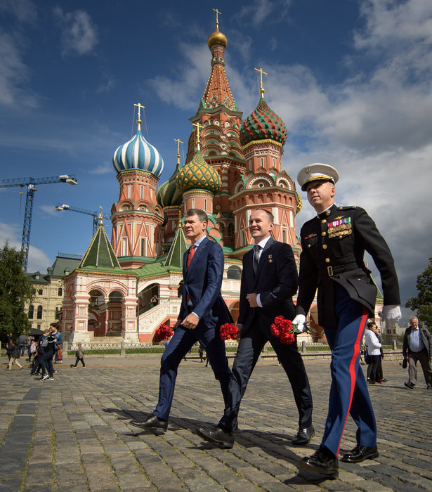 Expedition 52 flight engineers Paolo Nespoli of ESA, left, Sergey Ryazanskiy of Roscosmos, center, and Randy Bresnik of NASA visit Red Square to lay roses at the site where Russian space icons are interred as part of traditional pre-launch ceremonies, Monday, July 10, 2017 in Moscow. Photo Credit: (NASA/Bill Ingalls)